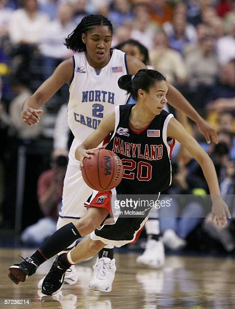 Kristi Toliver of the Maryland Terrapins spins around Erlana Larkins of the North Carolina Tar Heels during the 2006 Women's NCAA Basketball...