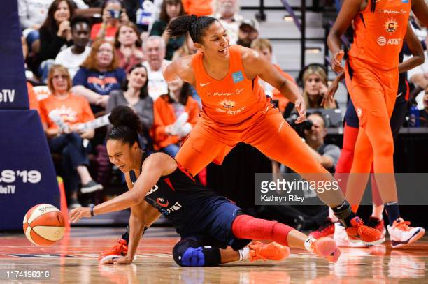 Kristi Toliver of the Washington Mystics dives for the ball against Alyssa Thomas of the Connecticut Sun in the third quarter of Game 3 of the WNBA...