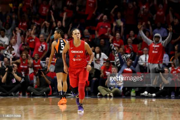Kristi Toliver of Washington Mystics celebrates after hitting a three pointer against the Connecticut Sun in the first half during Game Five of the...