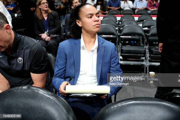 Kristi Toliver sits on the bench as an assistant coach of Washington Wizards during a preseason game against the Miami Heat on October 5 2018 at...