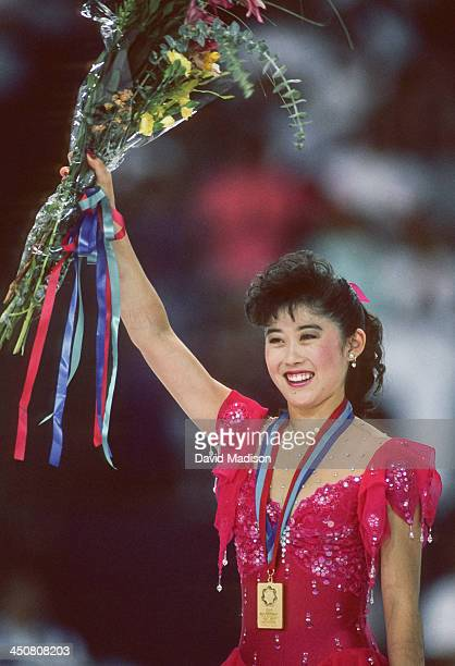 Kristi Yamaguchi of the USA celebrates her gold medal during the awards ceremony for the Women's Individual figure skating event of the 1990 Goodwill...