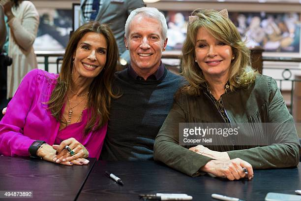 Kristian Alfonso Greg Meng and Deidre Hall pose for a photo during the Days of Our Lives book signing at Barnes and Noble on October 29 2015 in...