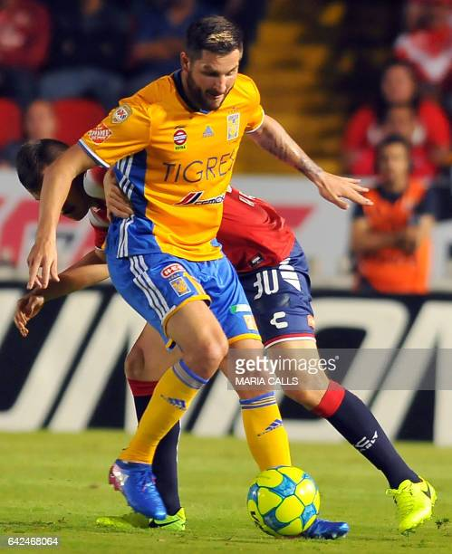 Kristian Alvarez of Veracruz vies for the ball with Andre Gignac of Tigres during their Mexican Clausura 2017 Tournament football match at Luis...