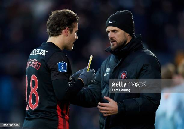 Kristian Bach Bak assistant coach of FC Midtjylland speaks to Erik Sviatchenko of FC Midtjylland during the Danish Alka Superliga match between FC...