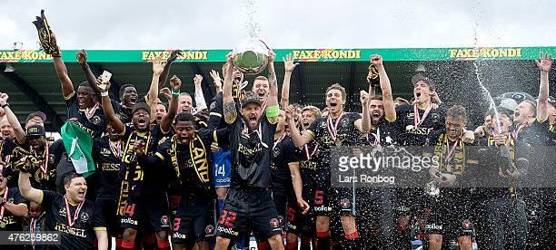 Kristian Bach Bak of FC Midtjylland celebrates and lifts the Alka Superliga Trophy as Danish Champions after the Danish Alka Superliga match between...