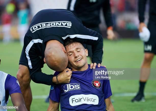 Kristian Back Bak assistant coach of FC Midtjylland and Mikkel Duelund of FC Midtjylland celebrate after the Danish Superliga match between Vejle...
