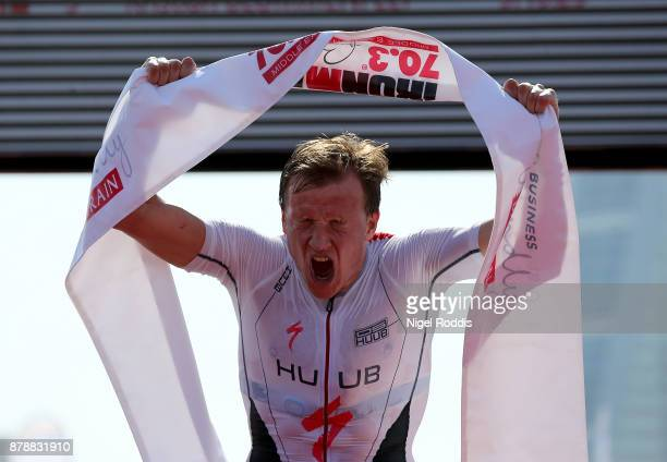 Kristian Blummenfelt of Norway celebrates winning Ironman 703 Middle East Championship Bahrain on November 25 2017 in Bahrain Bahrain