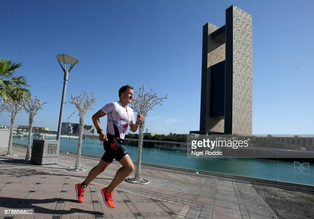 Kristian Blummenfelt of Norway competes in the run section of Ironman 703 Middle East Championship Bahrain on November 25 2017 in Bahrain Bahrain