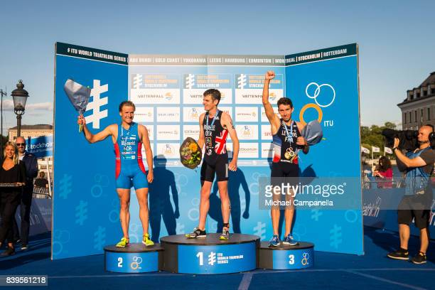 Kristian Blummenfelt of Norway Jonathan Brownlee of Great Britain and Pierre Le Corre of France on the winner's podium after the men's elite race of...