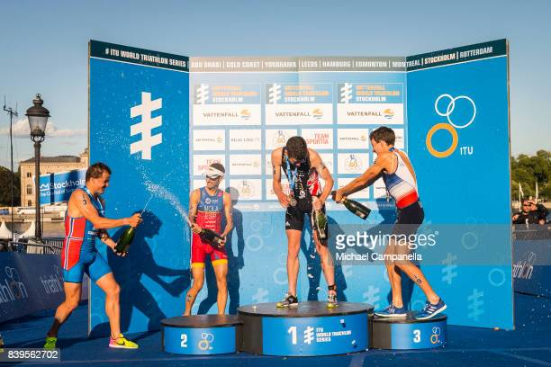 Kristian Blummenfelt of Norway Mario Mola of Spain Jonathan Brownlee of Great Britain and Pierre Le Corre of France spray champagne on the winner's...