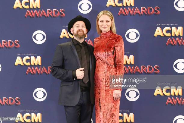 Kristian Bush and Jennifer Nettles of musical group Sugarland pose in the press room during the 53rd Academy of Country Music Awards at MGM Grand...