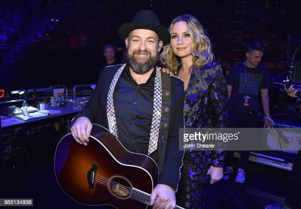 Kristian Bush and Jennifer Nettles of musical group Sugarland pose backstage at the 2018 iHeartCountry Festival By ATT at The Frank Erwin Center on...