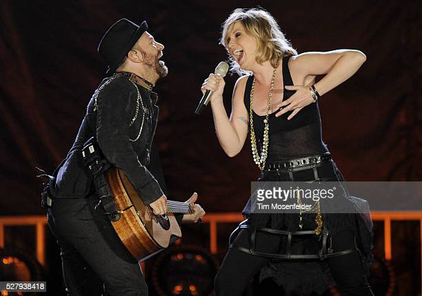 Kristian Bush and Jennifer Nettles of Sugarland perform part of the bands' Incredible Machine Tour at Raley Field in Sacramento, California.