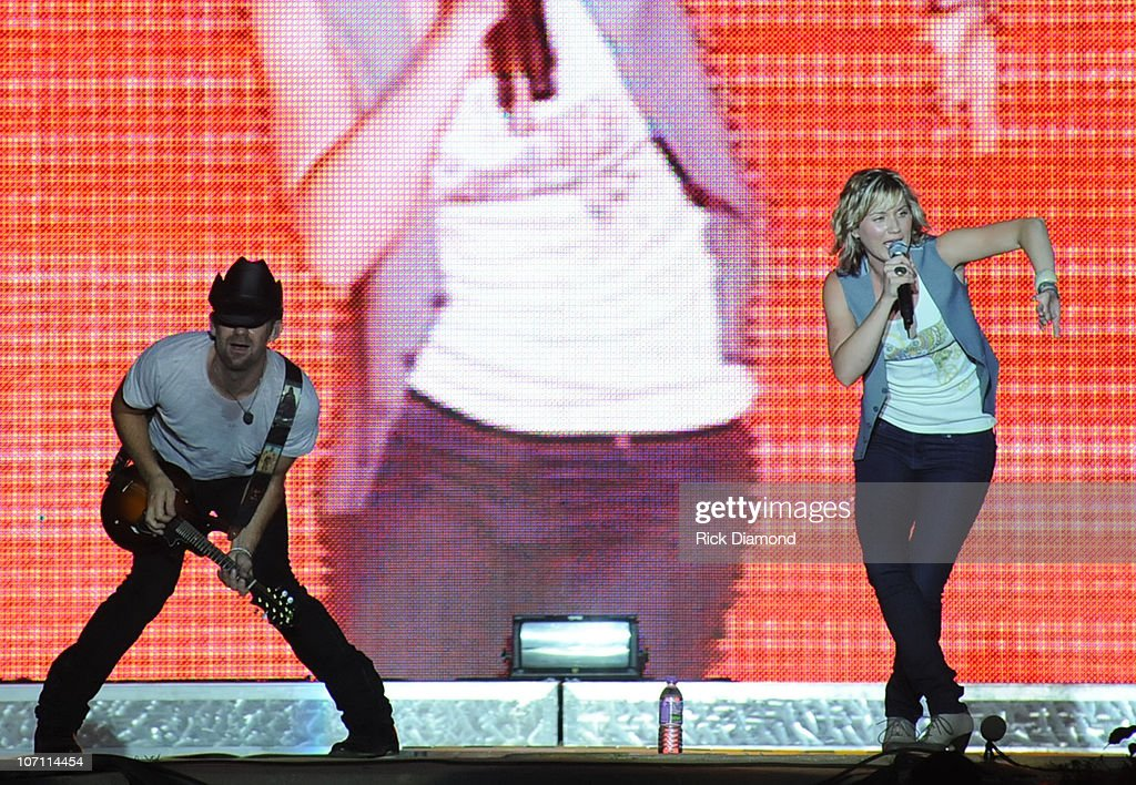Kristian Bush and Jennifer Nettles of the group Sugarland performs during the 16th annual Country Thunder festival on July 18, 2008 on Shadow Hill Farm in Twin Lakes, Wisconsin.