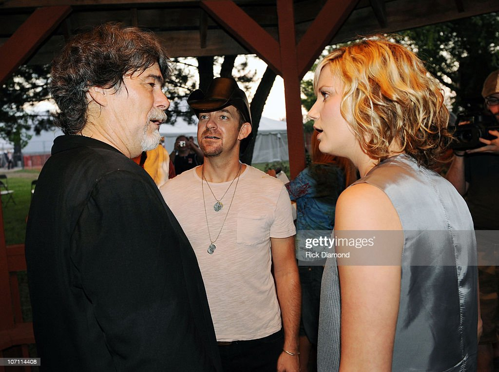 Kristian Bush center) and Jennifer Nettles (right) of The Group Sugarland stand in Randy Owen's ( formally of the group Alabama) Meet & Greet line and surprise him during the 16th annual Country Thunder festival on July 18, 2008 on Shadow Hill Farm in Twin Lakes, Wisconsin.