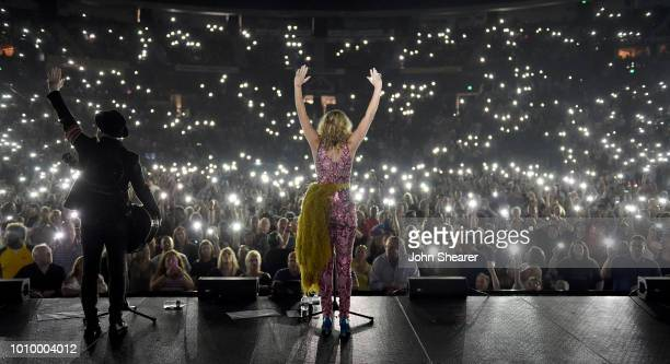 Kristian Bush left and Jennifer Nettles of Sugarland perform at Bridgestone Arena on August 2 2018 in Nashville Tennessee