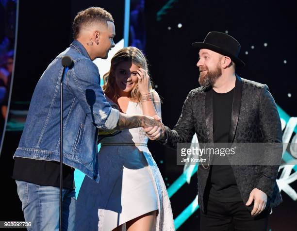 Kristian Bush of Sugarland presents Kane Brown and Lauren Alaina with an award at the 2018 CMT Music Awards at Bridgestone Arena on June 6 2018 in...