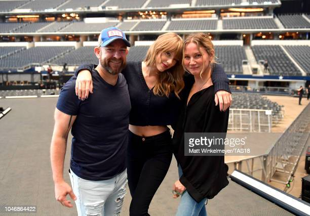 Kristian Bush Taylor Swift and Jennifer Nettles pose onstage during the rehearsals for the reputation Stadium Tour at ATT Stadium on October 6 2018...