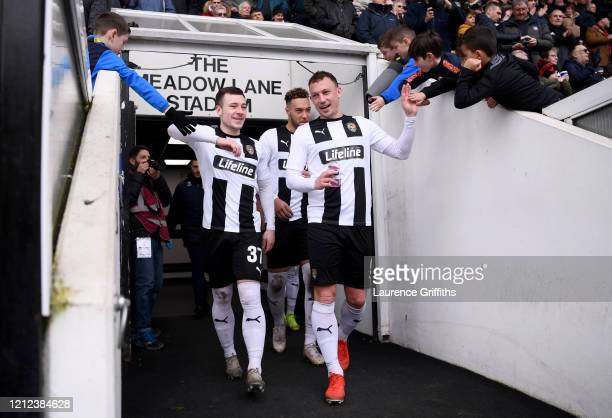 Kristian Dennis and Callum Roberts of Notts County high five and elbow fans as they walk out for the second half during the Vanarama National League...