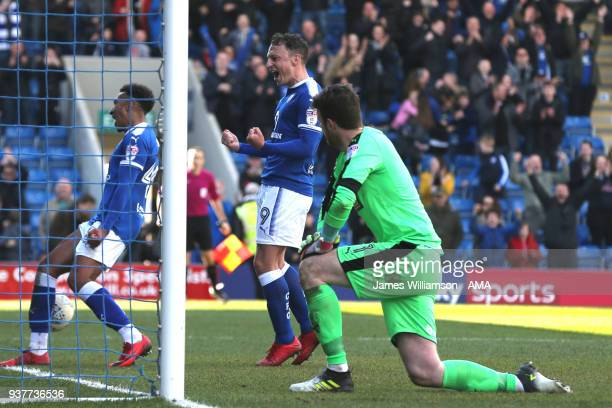 Kristian Dennis of Chesterfield celebrates after scoring a goal to make it 31 as a dejected Adam Collin of Notts County looks on during the Sky Bet...
