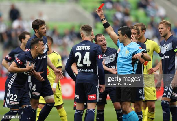 Kristian Dobras of the Victory is shown the red card by referee Stephen Lucas during the round 10 A-League match between the Melbourne Victory and...