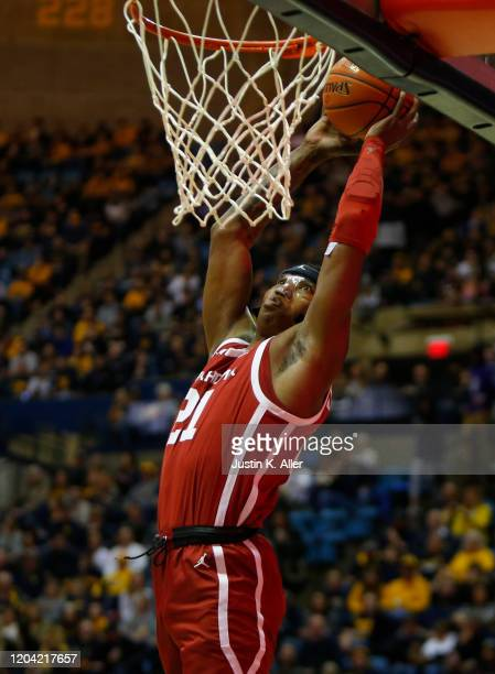 Kristian Doolittle of the Oklahoma Sooners dunks against the West Virginia Mountaineers at the WVU Coliseum on February 29 2020 in Morgantown West...