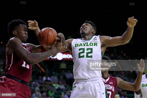 Kristian Doolittle of the Oklahoma Sooners fouls King McClure of the Baylor Bears in the second half at Ferrell Center on February 21 2017 in Waco...