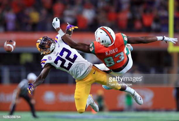 Kristian Fulton of the LSU Tigers breaks up a pass intended for Evidence Njoku of the Miami Hurricanes in the fourth quarter of The AdvoCare Classic...