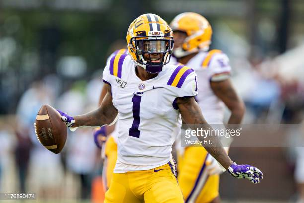 Kristian Fulton of the LSU Tigers celebrates after intercepting a pass during a game against the Mississippi State Bulldogs at Davis Wade Stadium on...