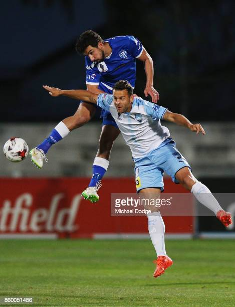 Kristian Konstantinidis of South Melbourne competes for the ball over Deyvison Rogerio Da Silva of Sydney FC during the FFA Cup Semi Final match...