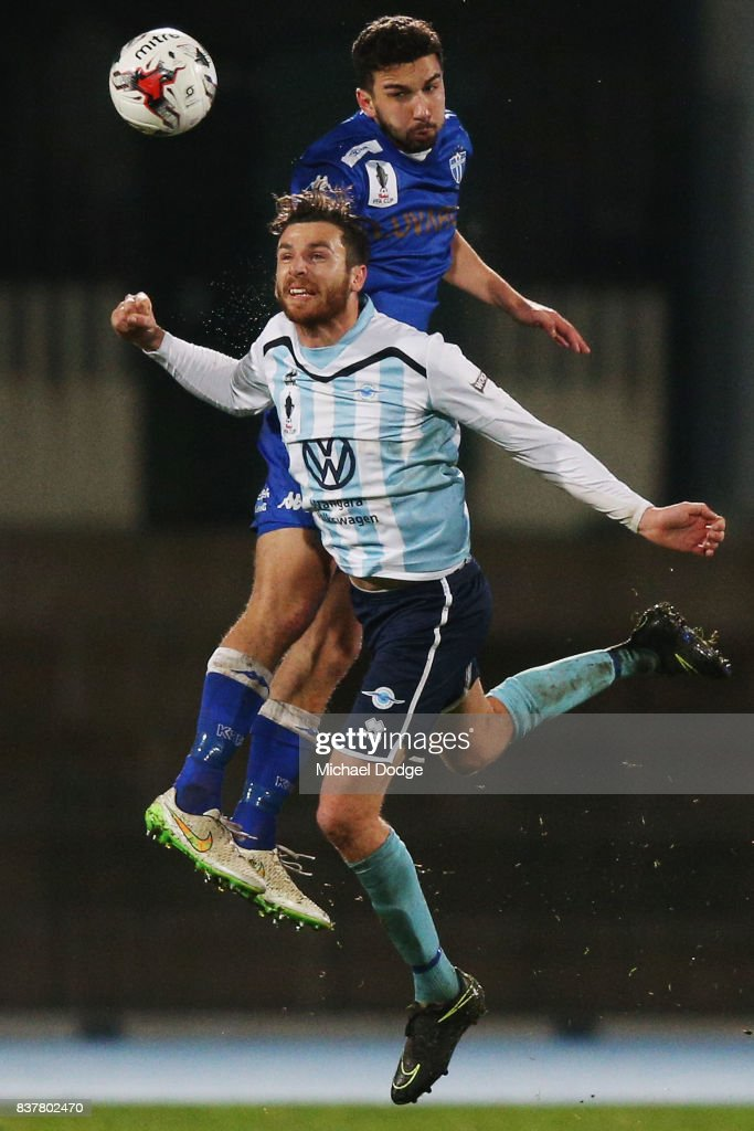 Kristian Konstantinidis of South Melbourne heads the ball over Alex Morgan of Sorrento during the FFA Cup round of 16 match between between South Melbourne FC and Sorrento FC at Lakeside Stadium on August 23, 2017 in Melbourne, Australia.