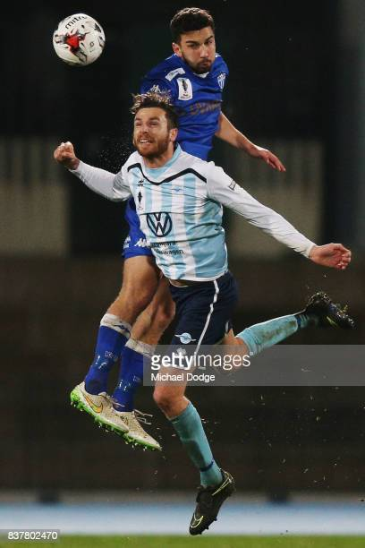 Kristian Konstantinidis of South Melbourne heads the ball over Alex Morgan of Sorrento during the FFA Cup round of 16 match between between South...