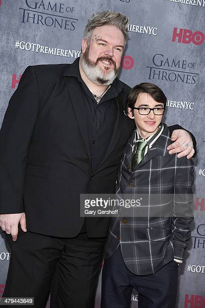 Kristian Nairn and Isaac Hempstead Wright attend the Game Of Thrones Season 4 premiere at Avery Fisher Hall Lincoln Center on March 18 2014 in New...