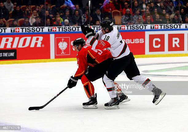 Kristian Nakyva of Lulea battles for the puck with Mattias Janmark of Gothenburg during the Champions Hockey League final match at Coop Norrbotten...