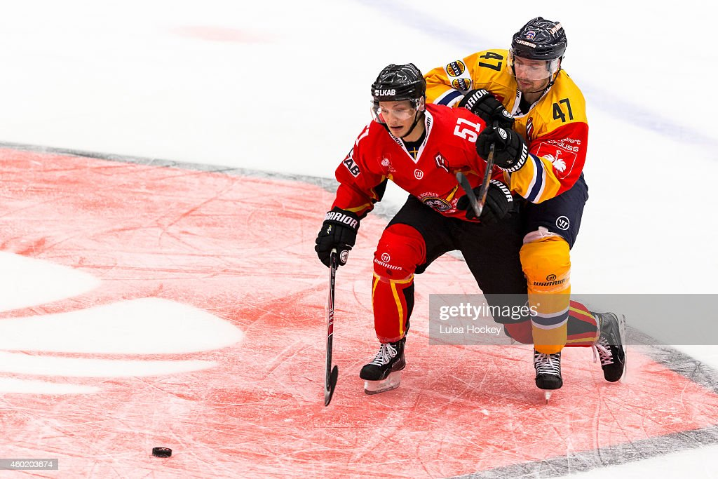 Kristian Nakyva #51 of Lulea Hockey and Janne Lahti #47 of Lukko Rauma chase the puck during the Champions Hockey League quarter final second leg game between Lulea Hockey and Lukko Rauma at Coop Norrbotten Arena on December 9, 2014 in Lulea, Sweden.