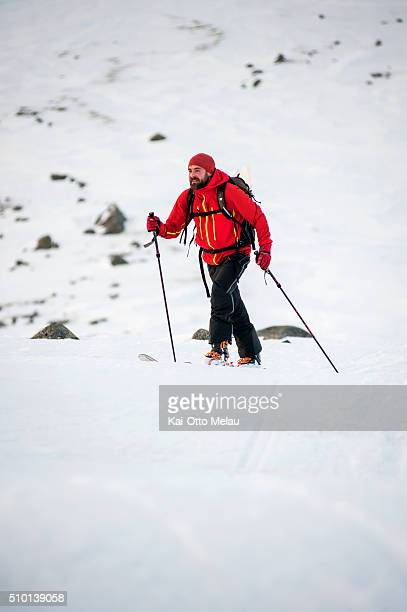 Kristian Nashoug making his way up the mountain pass on February 13 2016 in Svolvar Norway The water temperature is around 4c and after the swimleg...