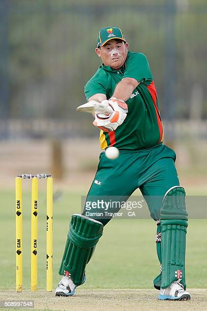 Kristian Nikolai of Tasmania hits a ball to bring up his 50 against Siuth Australia on day 1 of the National Indigenous Cricket Championships on...