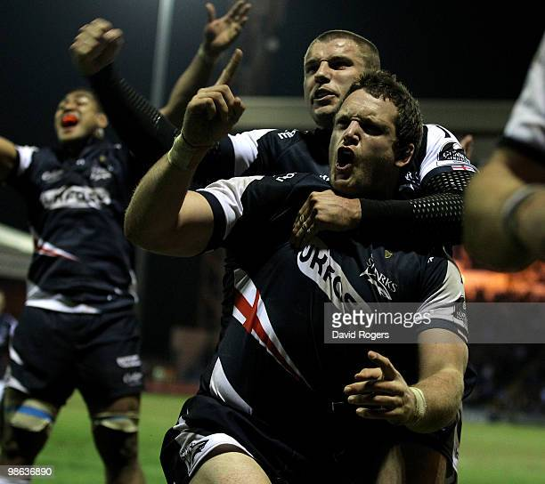 Kristian Ormsby of Sale celebrates with team mate Ben Cohen after scoring a try during the Guinness Premiership match between Sale Sharks and...