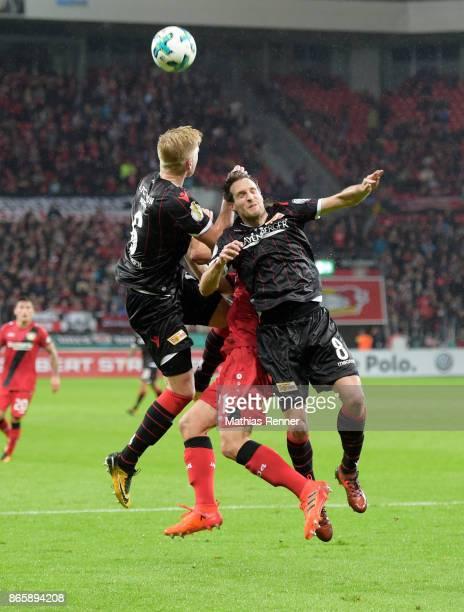Kristian Pedersen of 1 FC Union Berlin Dominik Kohr of Bayer 04 Leverkusen and Stephan Fuerstner of 1 FC Union Berlin during the DFBPokal match...