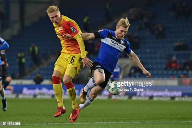Kristian Pedersen of Berlin and Andreas Voglsammer of Bielefeld fight for the ball during the Second Bundesliga match between DSC Arminia Bielefeld...