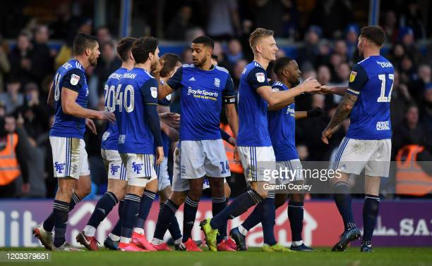 Kristian Pedersen of Birmingham City celebrates with teammates after scoring his team's second goal during the Sky Bet Championship match between...