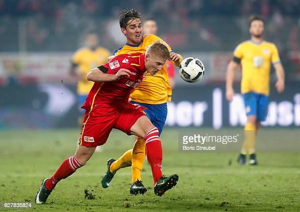 Kristian Pedersen of Union Berlin is challenged by Christoffer Nyman of Eintracht Brauschweig during the Second Bundesliga match between 1 FC Union...