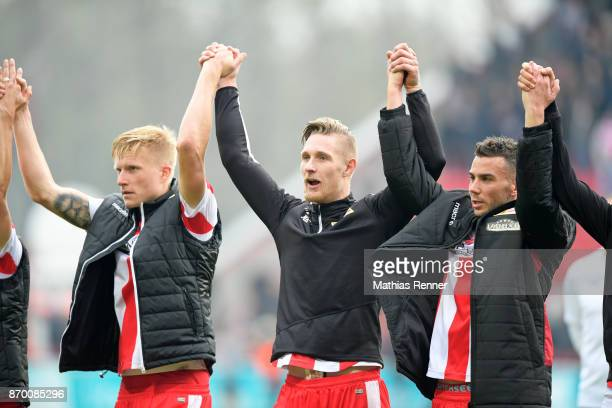 Kristian Pedersen Sebastian Polter and Dennis Daube of 1FC Union Berlin after the game between Union Berlin and dem FC St Pauli on November 4 2017 in...