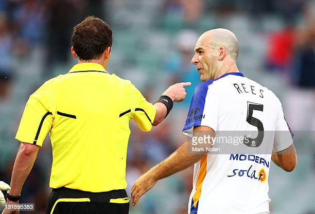 Kristian Rees of the Gold Coast argues with referee Peter Green after he awarded a penalty shot at goal in the dying moments during the round five...