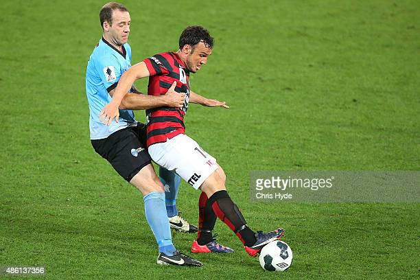 Kristian Rees of the Sharks and Mark Bridge of the Wanderers compete for the ball during the FFA Cup Round of 16 match between Palm Beach Sharks and...