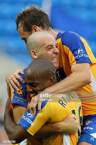 Kristian Rees of United is congratulated by teammates Maceo Rigters and Dylan Macallister after scoring a goal during the round four A-League match...