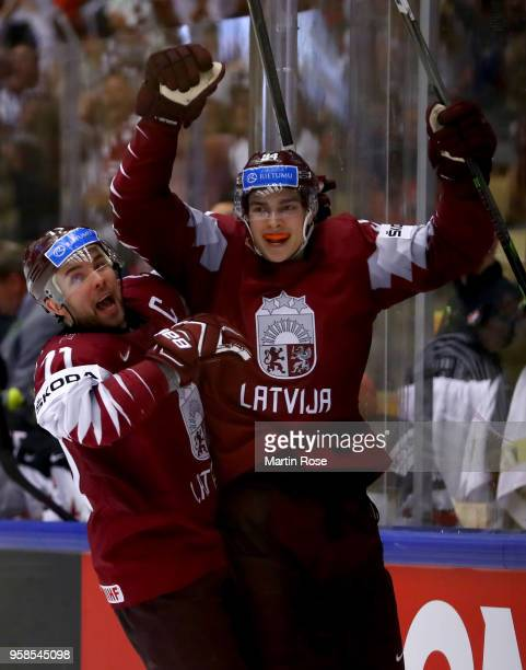 Kristian RUuins of Latvia celebrate with team mate Roberts Bukarts after he scores a goal the 2018 IIHF Ice Hockey World Championship Group B game...