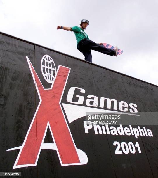 US Kristian Svitak warms up on the quarter pipe wall before the start of the Men's Skateboard Park Final's during the 2001 Summer X Games at the...