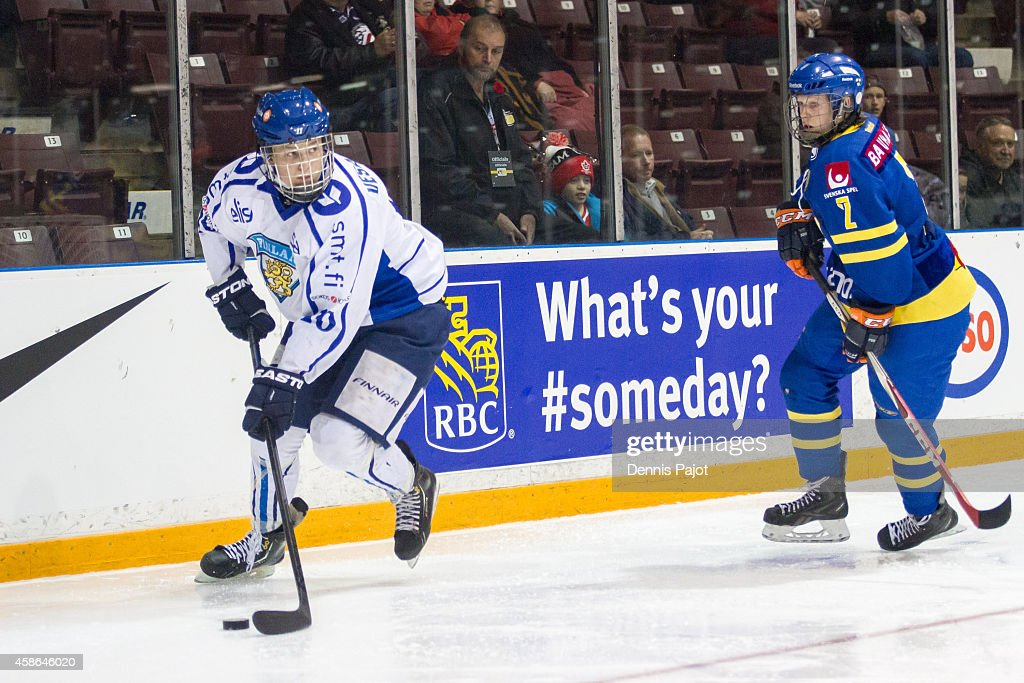 Kristian Veralainen #10 of Finland moves the puck against Alexander Andersson #2 Sweden during the bronze medal game at the World Under-17 Hockey Challenge on November 8, 2014 at the RBC Centre in Sarnia, Ontario.
