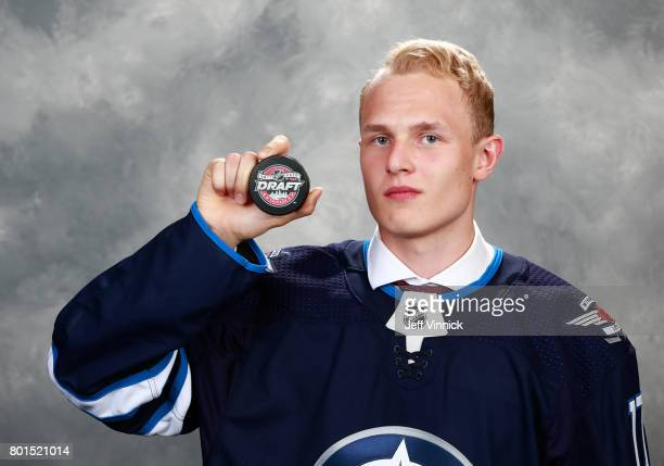 Kristian Vesalainen 24th overall pick of the Winnipeg Jets poses for a portrait during Round One of the 2017 NHL Draft at United Center on June 23...